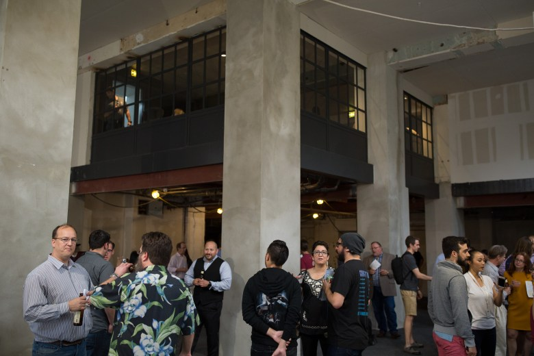 Tech Bloc guests congregate in a future space at the Maverick Apartments.