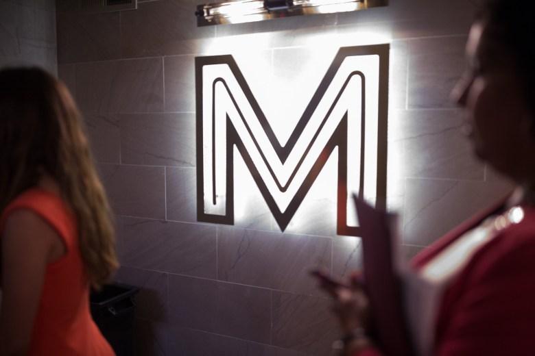 The Maverick Apartments' new logo adorns the entryway into a bank of elevators.
