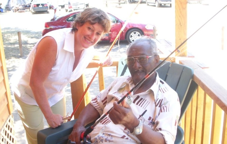 Moreese Bickham (right) on a fishing trip with Joan Cheever in July 2005.