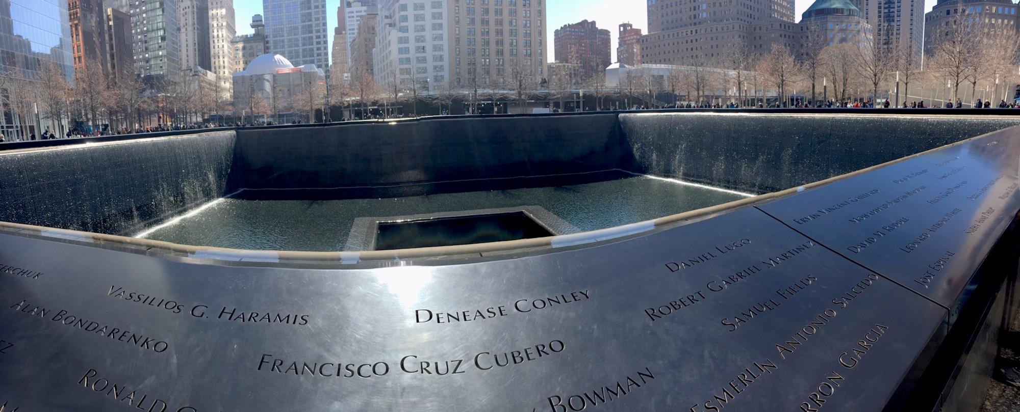 Water cascades into a deep fountain at the National September 11 Memorial.