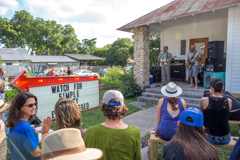 PorchFest attendees listen to the band, Keel In The Hurricane, at the 3301 N. Flores venue.