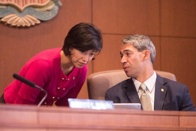 Councilwoman Ana Sandoval (D7) speaks with Mayor Ron Nirenberg in City Council Chambers.