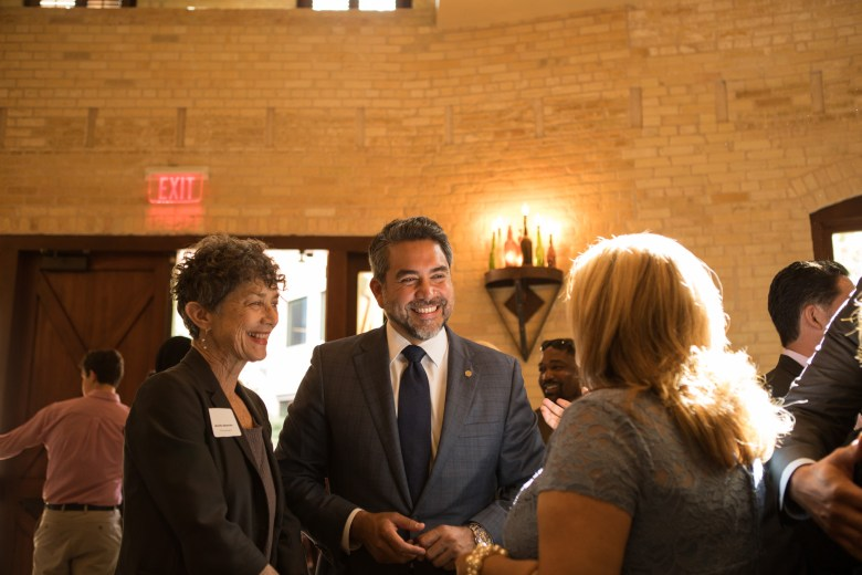 Monika Maeckle (left) and Councilman Roberto Treviño (D1) socialize before the reception honoring San Antonio's 2017 City Council leadership at the Pearl Stable.