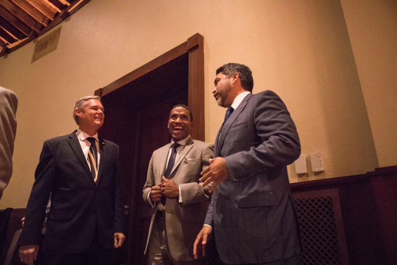 """(From left) Councilman Clayton Perry (D10), Councilman William """"Cruz"""" Shaw (D2), and Councilman Roberto Treviño (D1) share a laugh at the reception honoring San Antonio's 2017 City Council leadership at the Pearl Stable."""