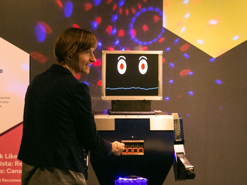DoSeum Exhibits Director Meredith Doby demonstrates how to use a robot in the DoSeum's new exhibit.