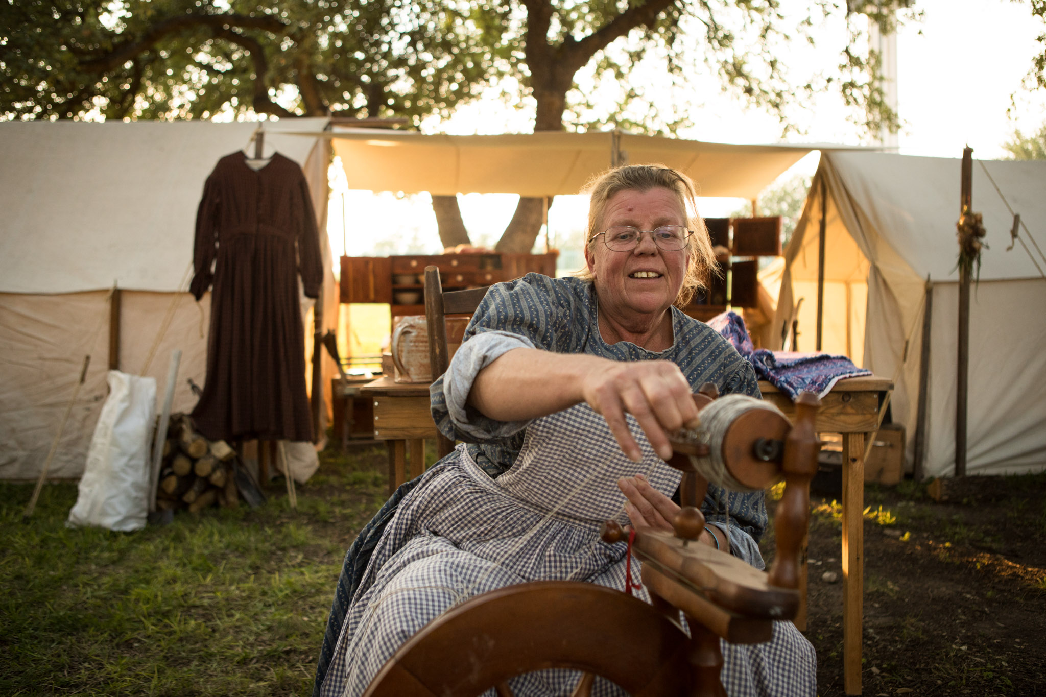 Ingrid Nabors poses as a 19th century spinner at the Texas Folklife Festival.