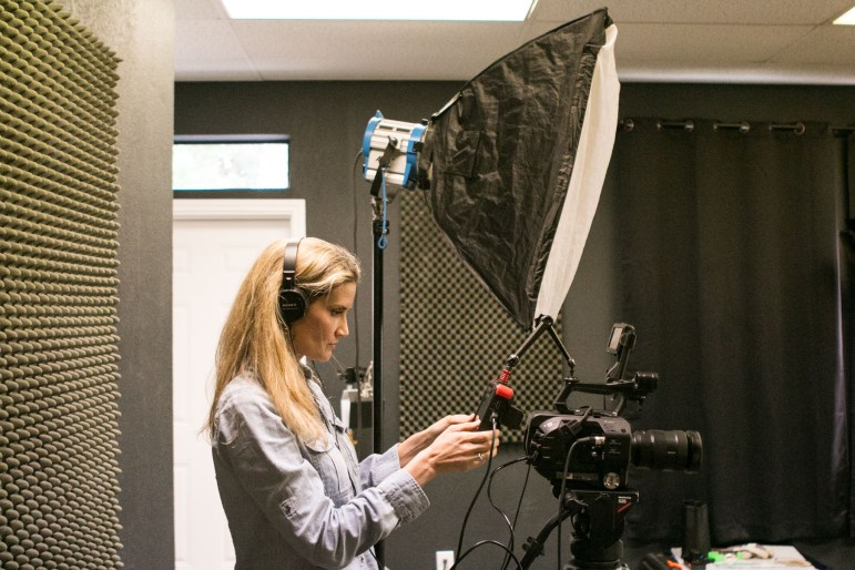 Innovative Multimedia Group President Heather Angel Chandler works with her video camera in the office's studio.