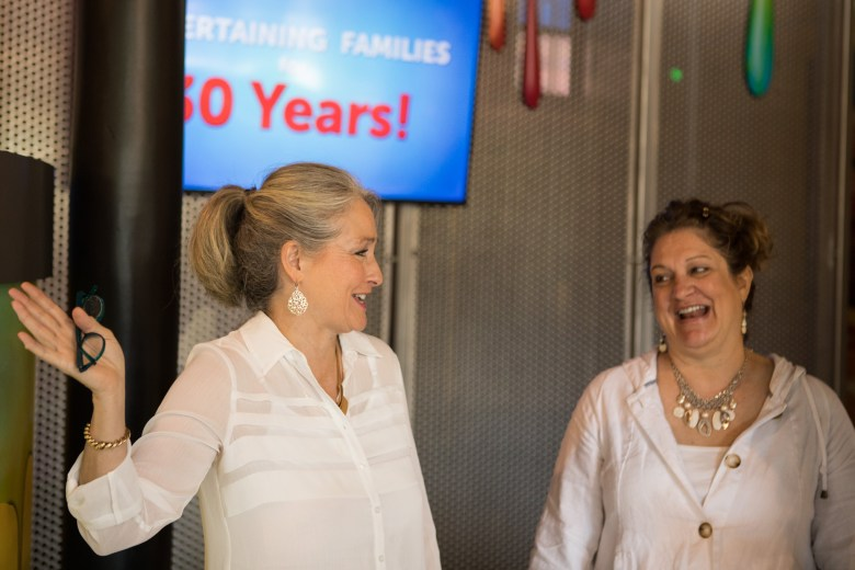 (From left) Paseo Del Rio Association Executive Director Maggie Thompson and Paseo Del Rio Association Director of Marketing & Public Relations Paula Schechter socialize before the announcement of the 30th Anniversary Celebration of Louis Tussaud's Waxworks.