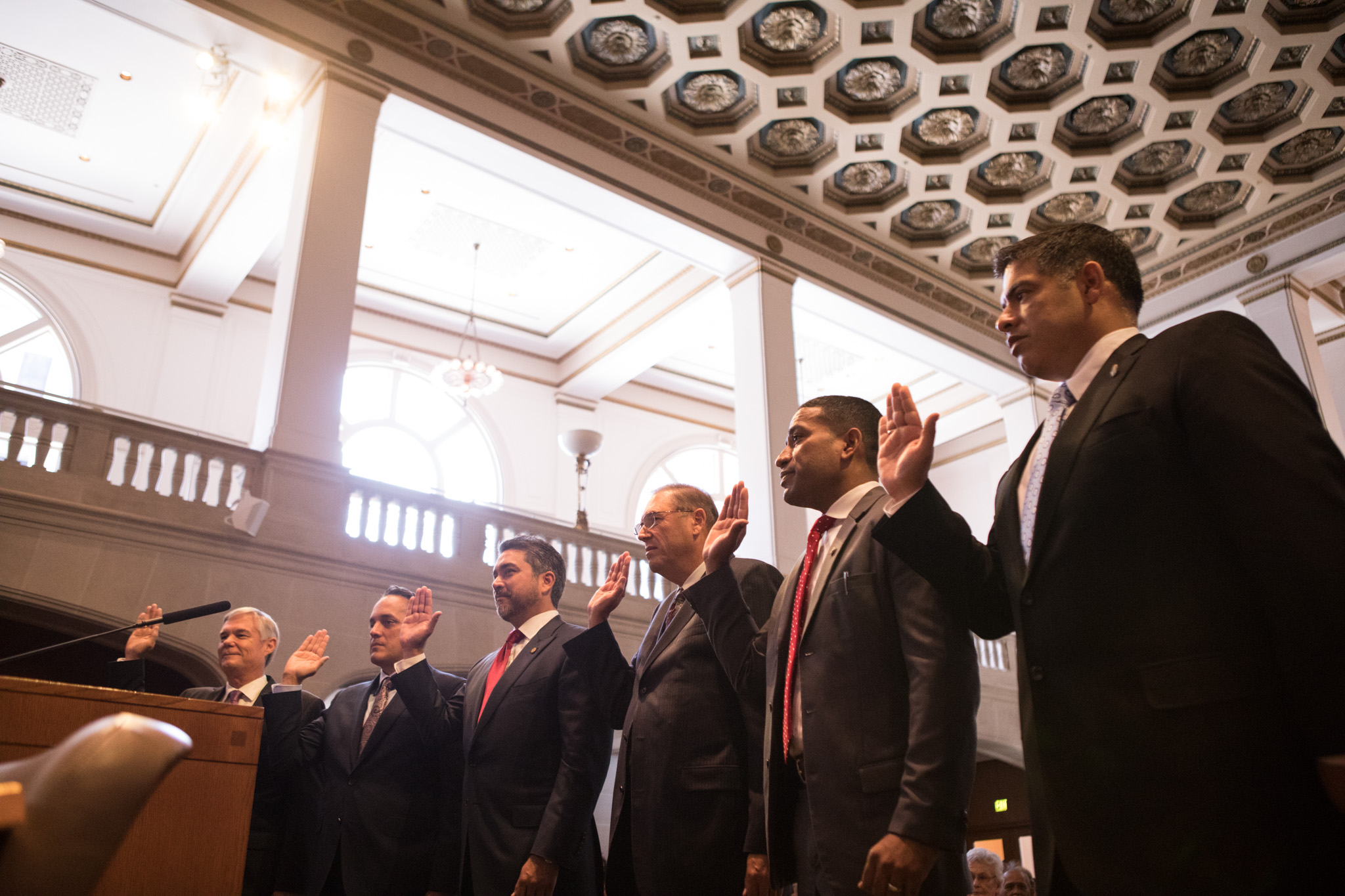 """(From left): Council members Clayton Perry (10), Greg Brockhouse (D9), Roberto Treviño (D1), and William """"Cruz"""" Shaw (D2) take the oath of office."""