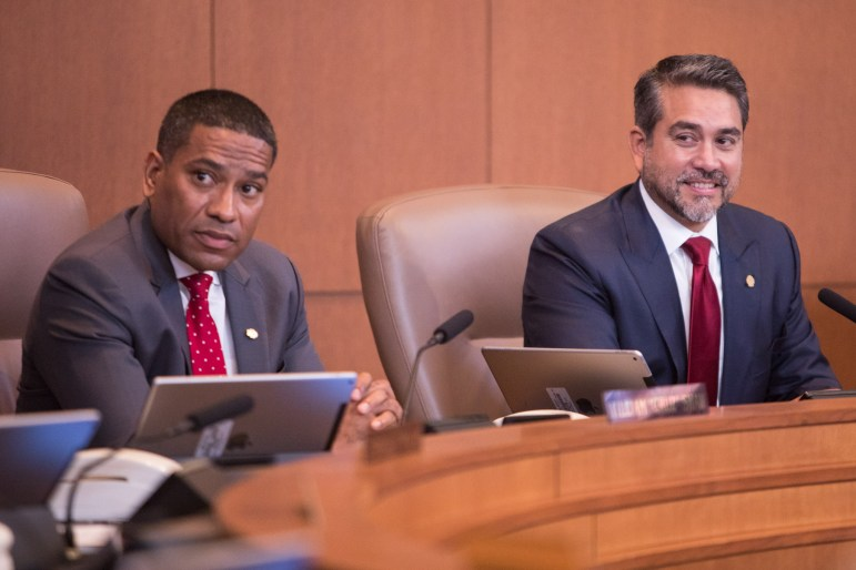 """Councilman William """"Cruz"""" Shaw (D2) and Councilman Roberto Treviño (D1) listen to other Council member's remarks about the outgoing Council."""