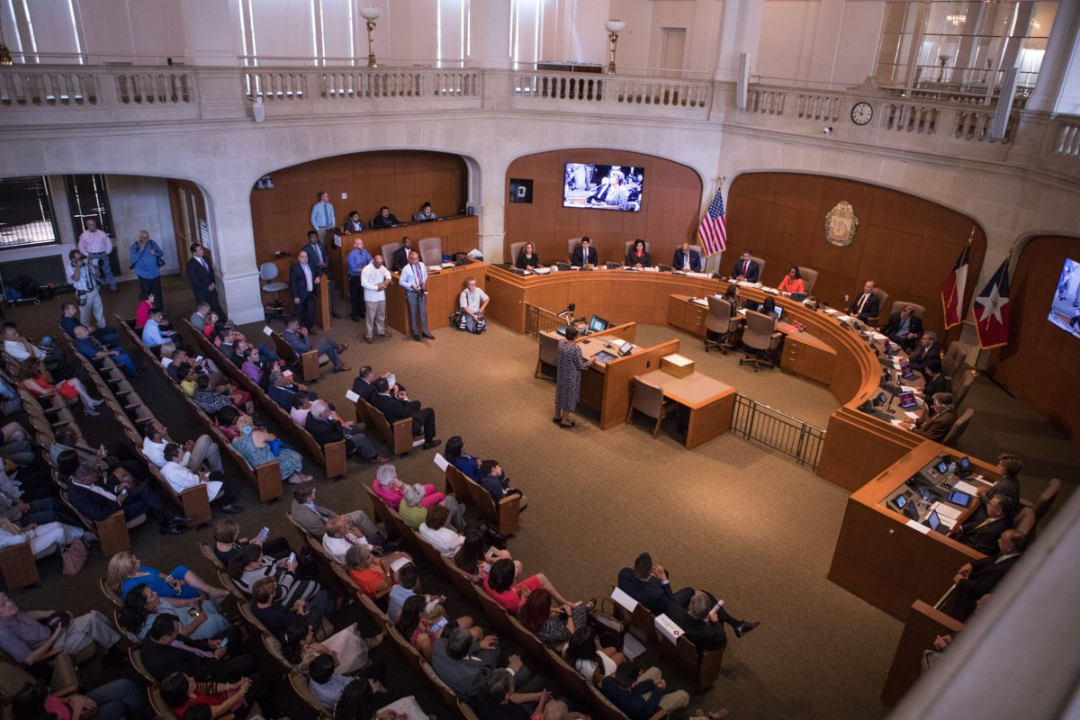 A large crowd gathers at City Council Chambers for the swearing in of the new council and mayor on June 21, 2017.