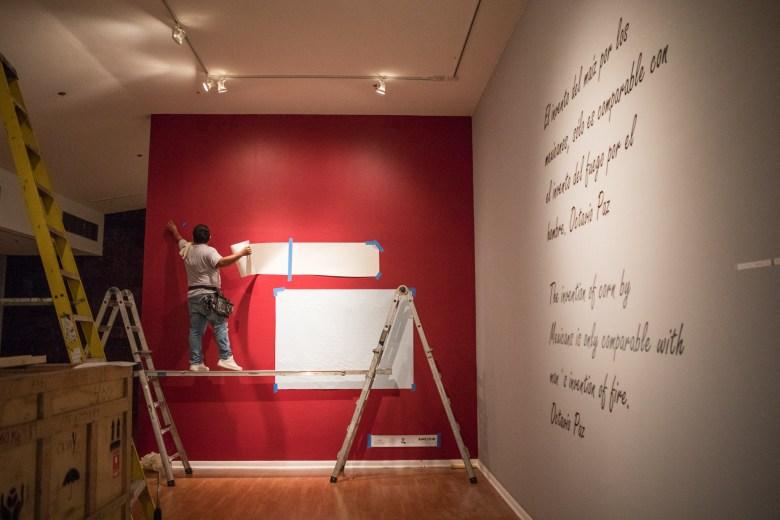Contractor Javier Ybarra installs Betsabeé Romero's exhibition in the Mexican Cultural Institute San Antonio.