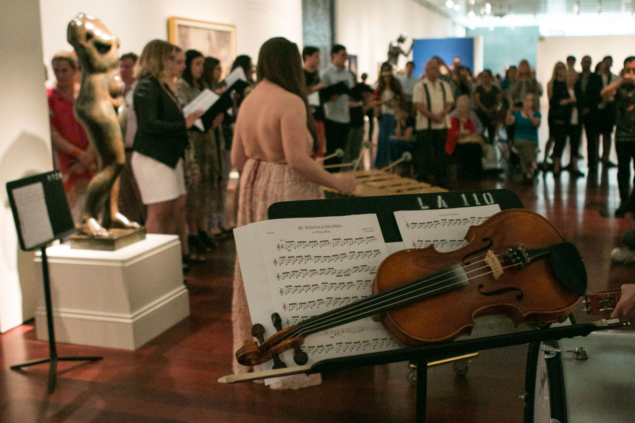 A violin is placed on a stand during the performance of From Those Who Follow The Echoes at the McNay Art Museum.
