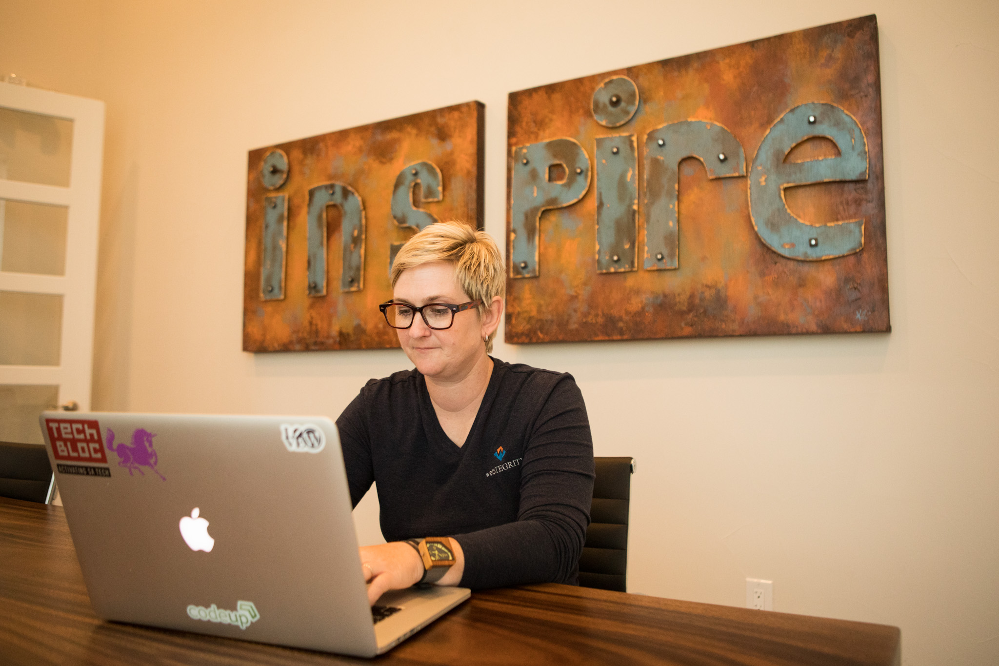 WebTegrity Co-Founder Kori Ashton works in the conference room of WebTegrity.