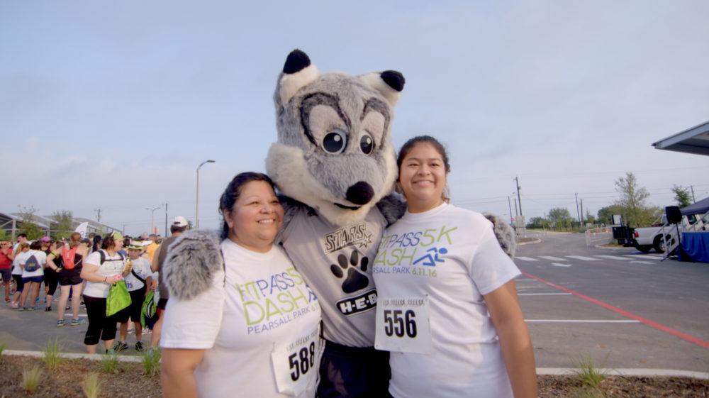 Fit Pass participants hug the San Antonio Silver Stars mascot at the 2016 kickoff event at Pearsall Park.