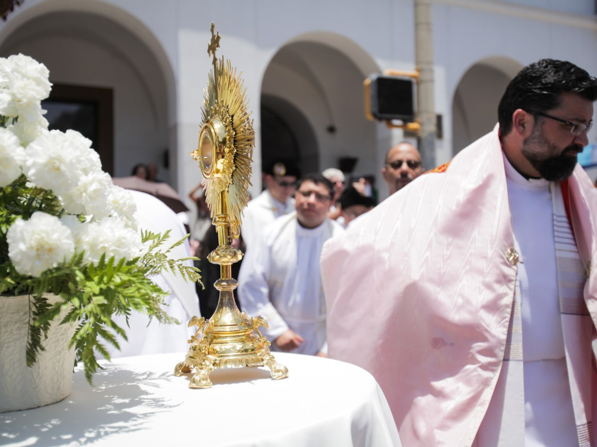The procession makes stops to honor the Eucharist during the Feast of Corpus Christi Procession.