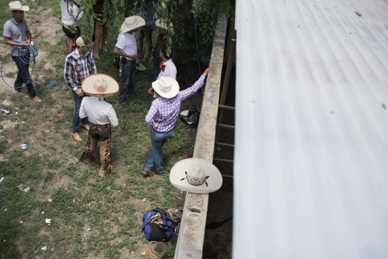 Competing charros chat with friends and family on the side lines during the 70th anniversary of the Charreada in San Antonio.