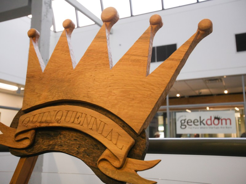 A quinquennial sign is posted outside geekdom head quarters.