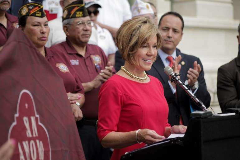 City manager Sheryl Sculley speaks at the unveiling of San Antonio as Military City USA in the Military Plaza.