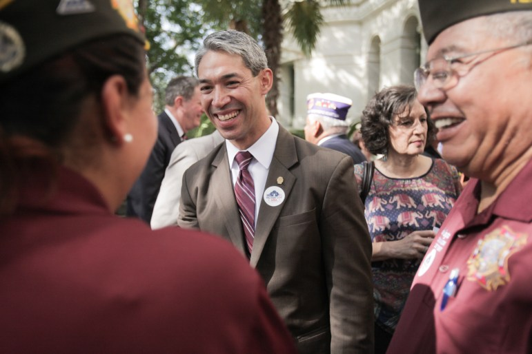 Mayor-elect Ron Nirenberg greets veterans at the unveiling and celebration of San Antonio's official Military City USA trademark.