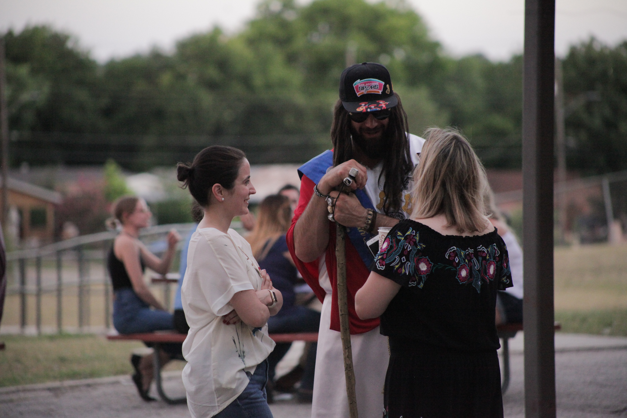 """Local icon Cord Maldonado commonly known as """"Spurs Jesus"""" chats with attendees before his presentation at PechaKucha."""