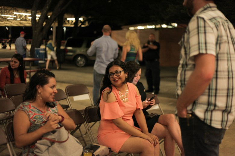 Nirenberg's deputy campaign manager Juany Torres chats with friends after her presentation at PechaKucha.