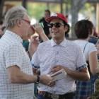 Creative John Mata (center) chats with emcee Gary Sweeny before speaking at PechaKucha.