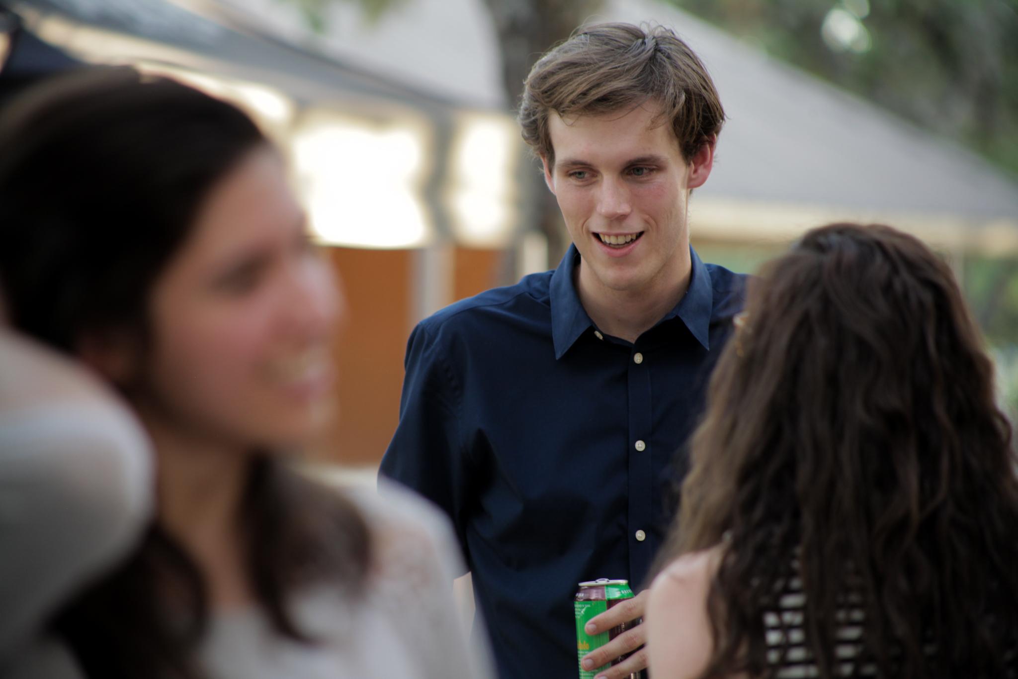 Artist Cade Bradshaw socializes before speaking at PechaKucha.