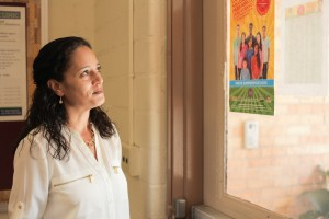 Senior Executive Director Jenny Arredondo at SAISD looks at the flyer and list of covered school for the summer food program.