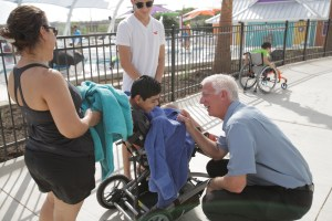 Gordon Hartman greets Diego Guzmán age 14 at the new waterpark at Morgan's Inspiration Island.