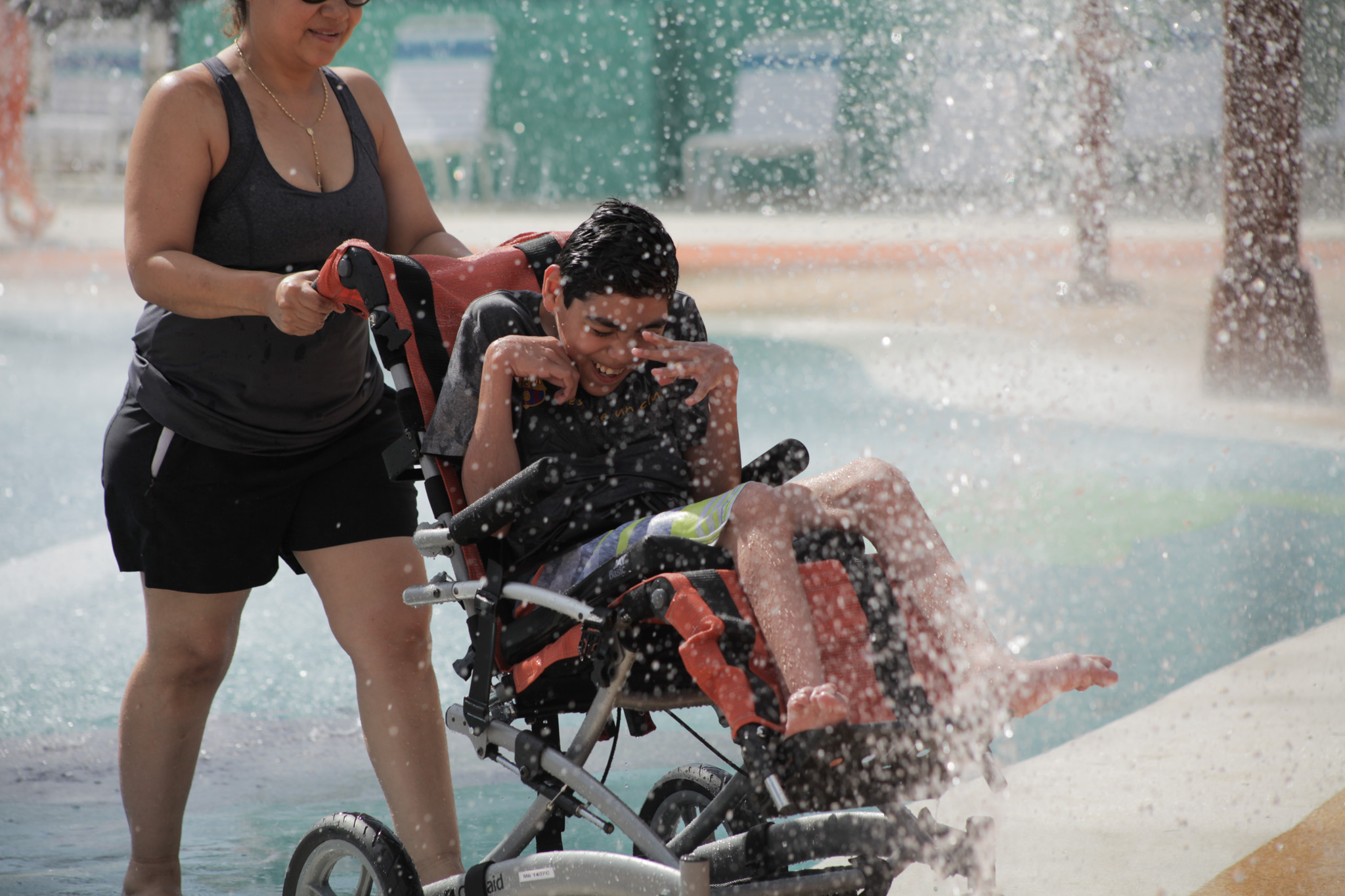 Diego Guzmán age 14 wipes water from his eyes the new waterpark at Morgan's Inspiration Island.