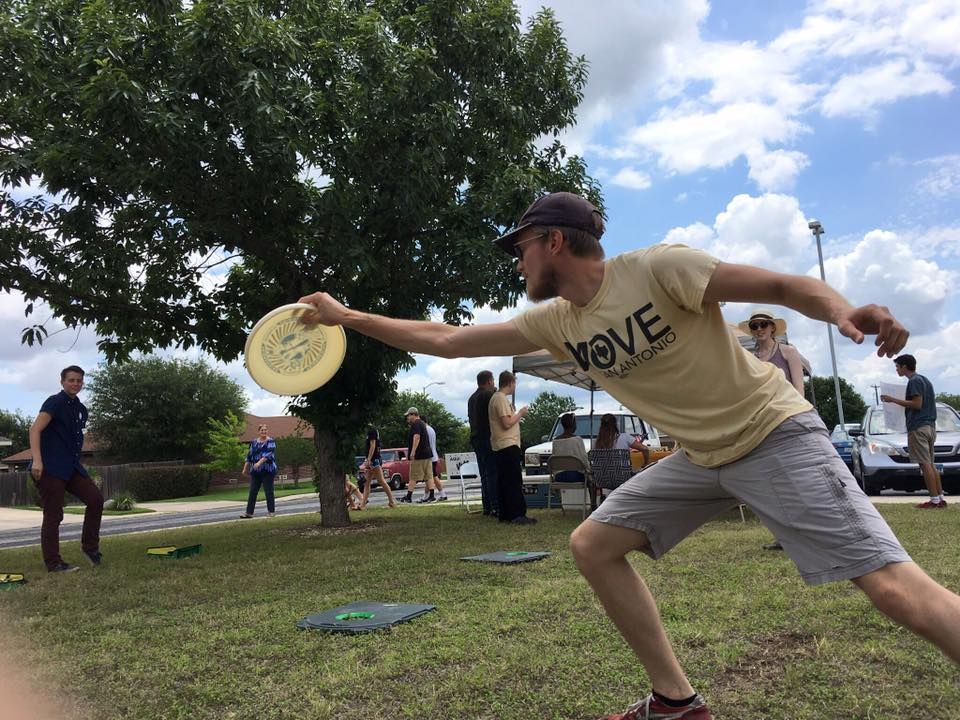 Move SA supporter and early voters play frisbee during the nonprofit's voting party in June.
