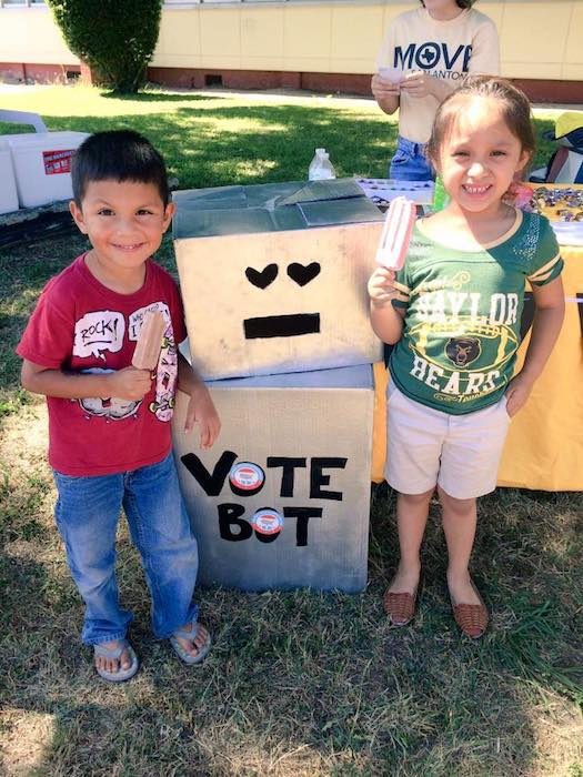 """Children hang out with """"Vote Bot"""" during Move SA's voting party on election day, May 6."""