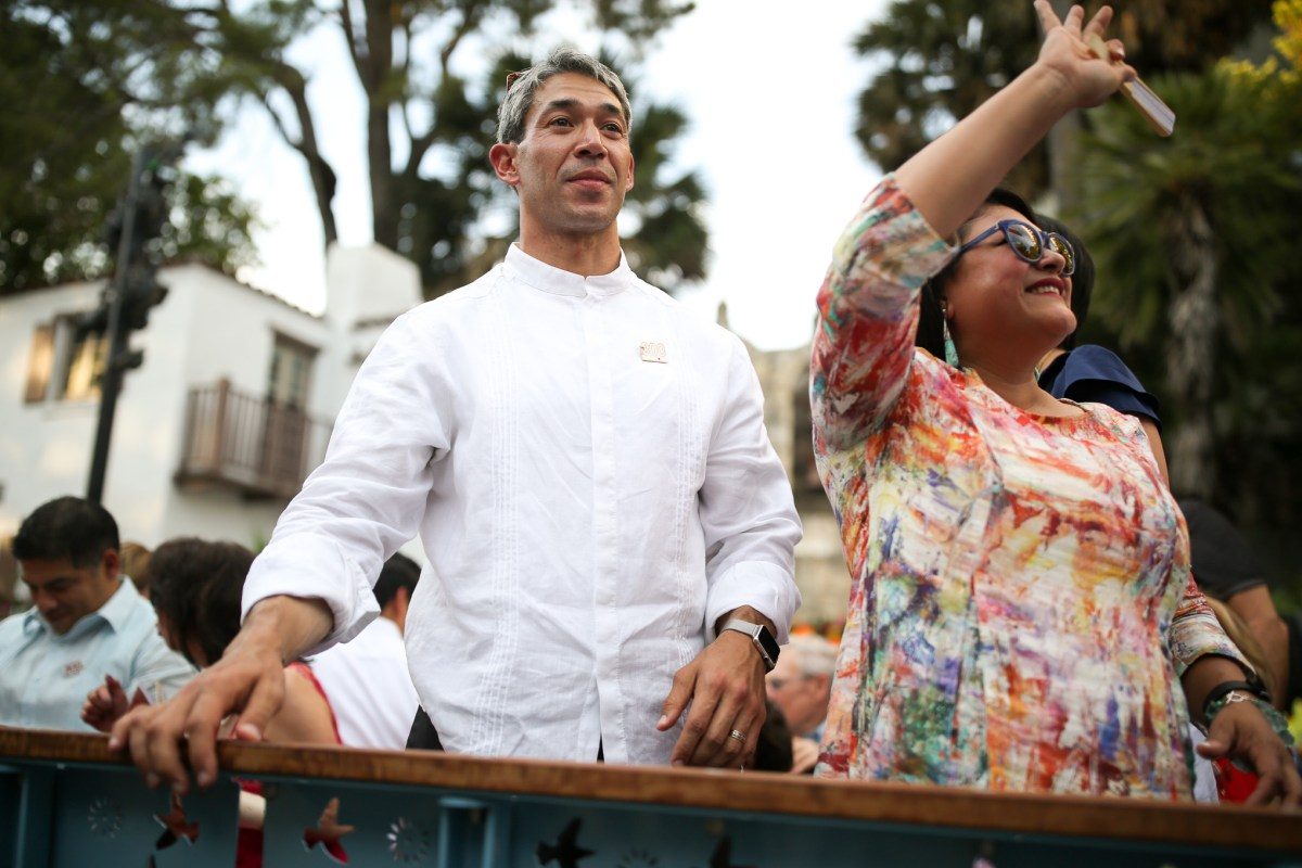 Mayor Ron Nirenberg and his wife Erika Prosper as the river barge disembarks following the inauguration ceremony.