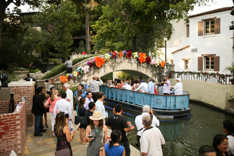 A newly designed river barge vacates the Arneson River Theatre with newly inaugurated city council and mayor on board.