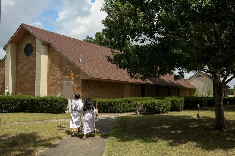 Chapel helpers head back to Sacred Heart of Jesus following Sunday mass.