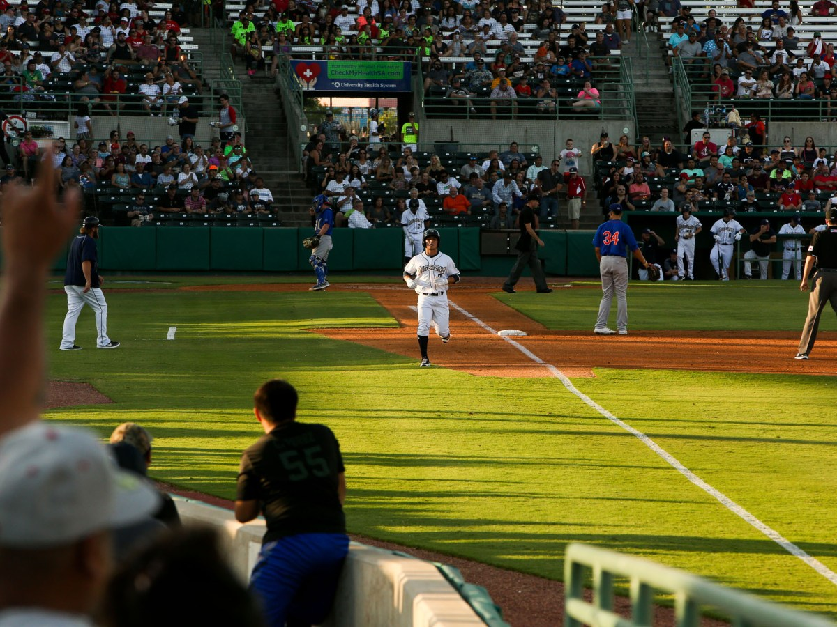 Fans react as Shortstop Luis Uruias brings in an RBI against the Midland Rockhounds.