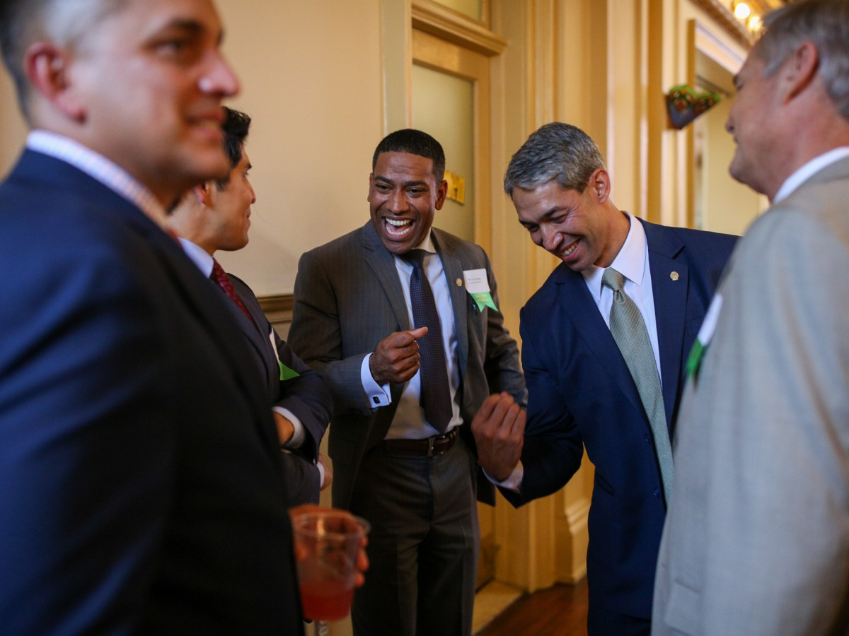 Mayor Ron Nirenberg and four members of his council joke together as they wait to be presented at the Depot at Sunset Station.