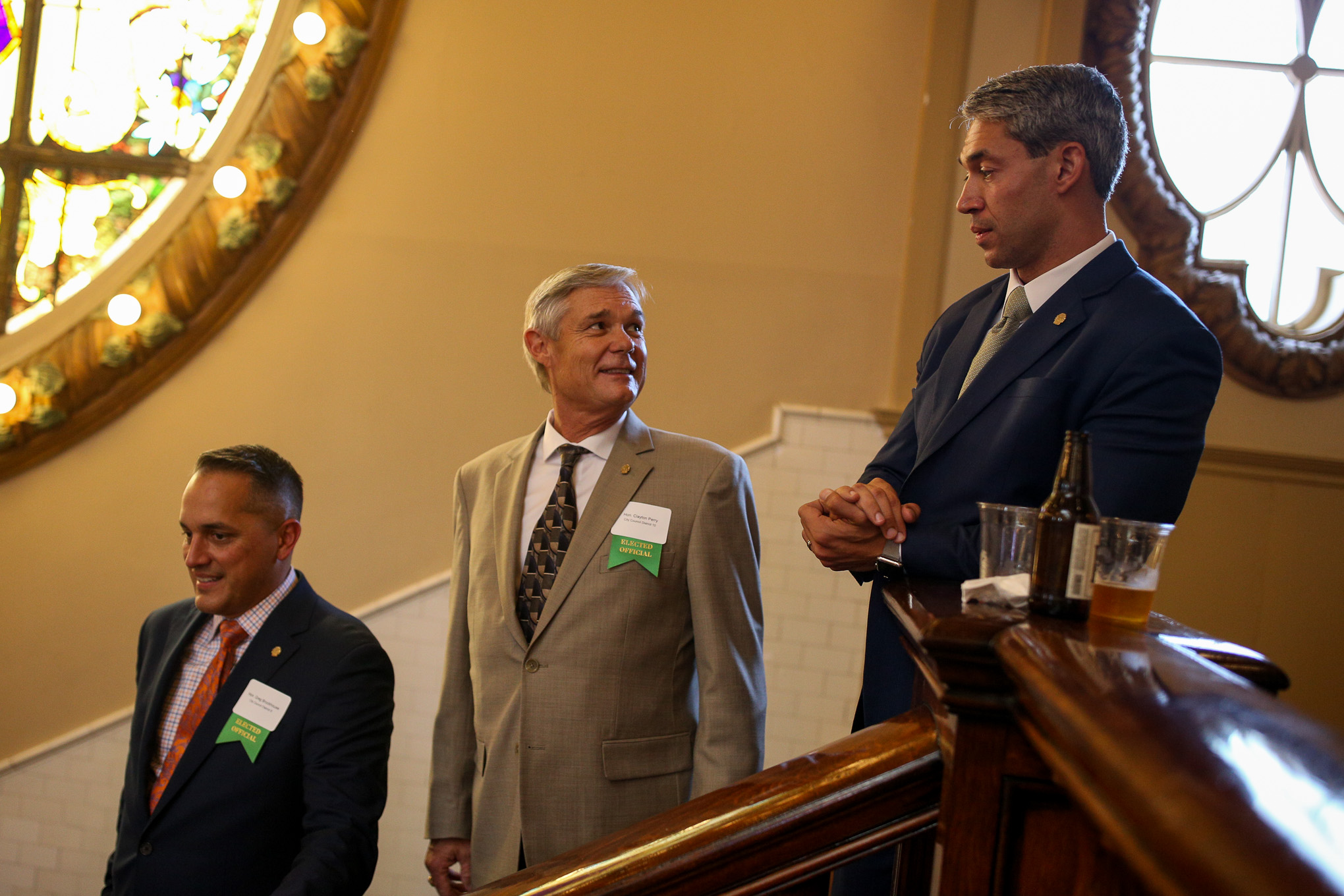 (from left) Councilman Greg Brockhouse (D6), Councilman Clayton Perry (D10), and Mayor Ron Nirenberg form a line to be introduced.