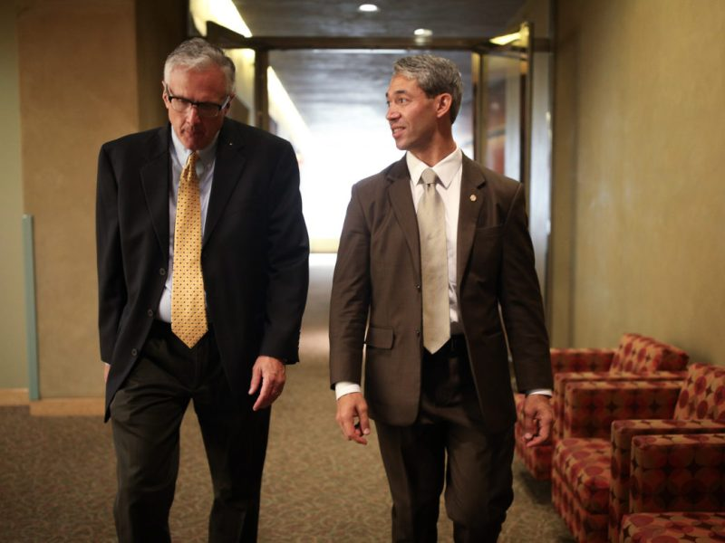 Mayor Ron Nirenberg walks with newly appointed Director of Communications Bruce Davidson following the signing of the Paris Agreement Tuesday morning.
