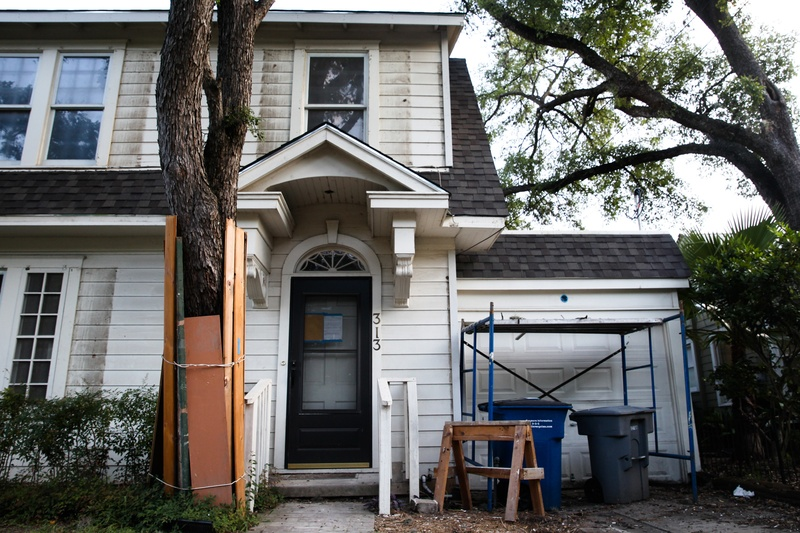 A tree is protected by wood planks during construction at a private residence in Austin on June 12, 2017.