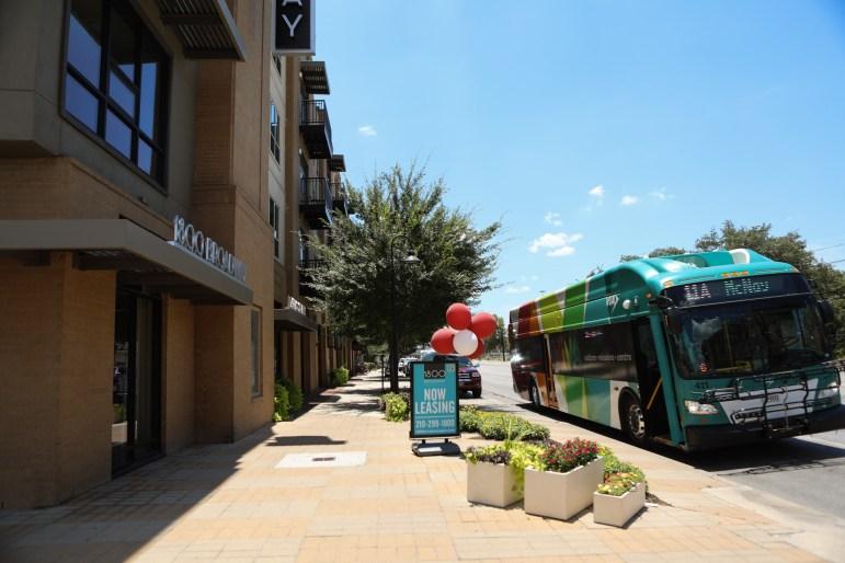 A VIA Metropolitan Transit bus stops in front of 1800 Broadway.