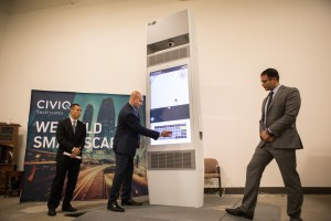 (From left) Office of the County Manager Chief of Staff Thomas Guevara, Bexar County IT Project Manager Phillip Rico, and Bexar County Project Manager Mohammad Benhalim demonstrate how to use the CIVIQ Waypoint Kiosk.