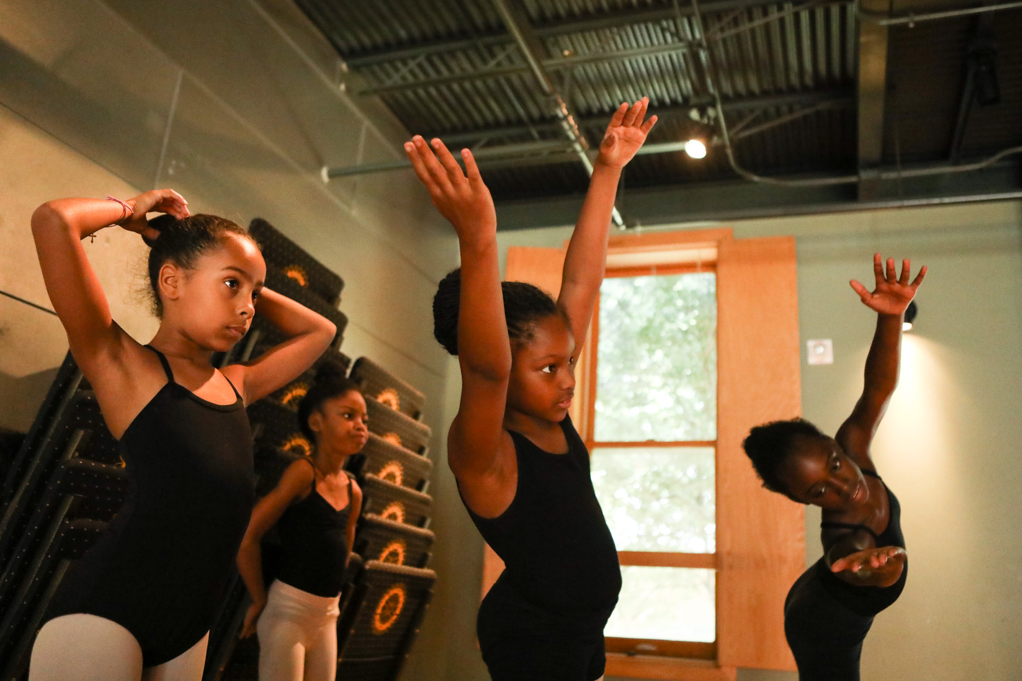 Dancers stretch during practice at Carver's Summer Dance Intensive Program taught by Dallas Black Dance Theatre professional dancers.