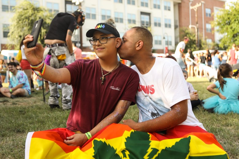 (From left) Eric Bake and Trevon Franklin pose for a selfie at the PRIDE Bigger Than Texas Festival.