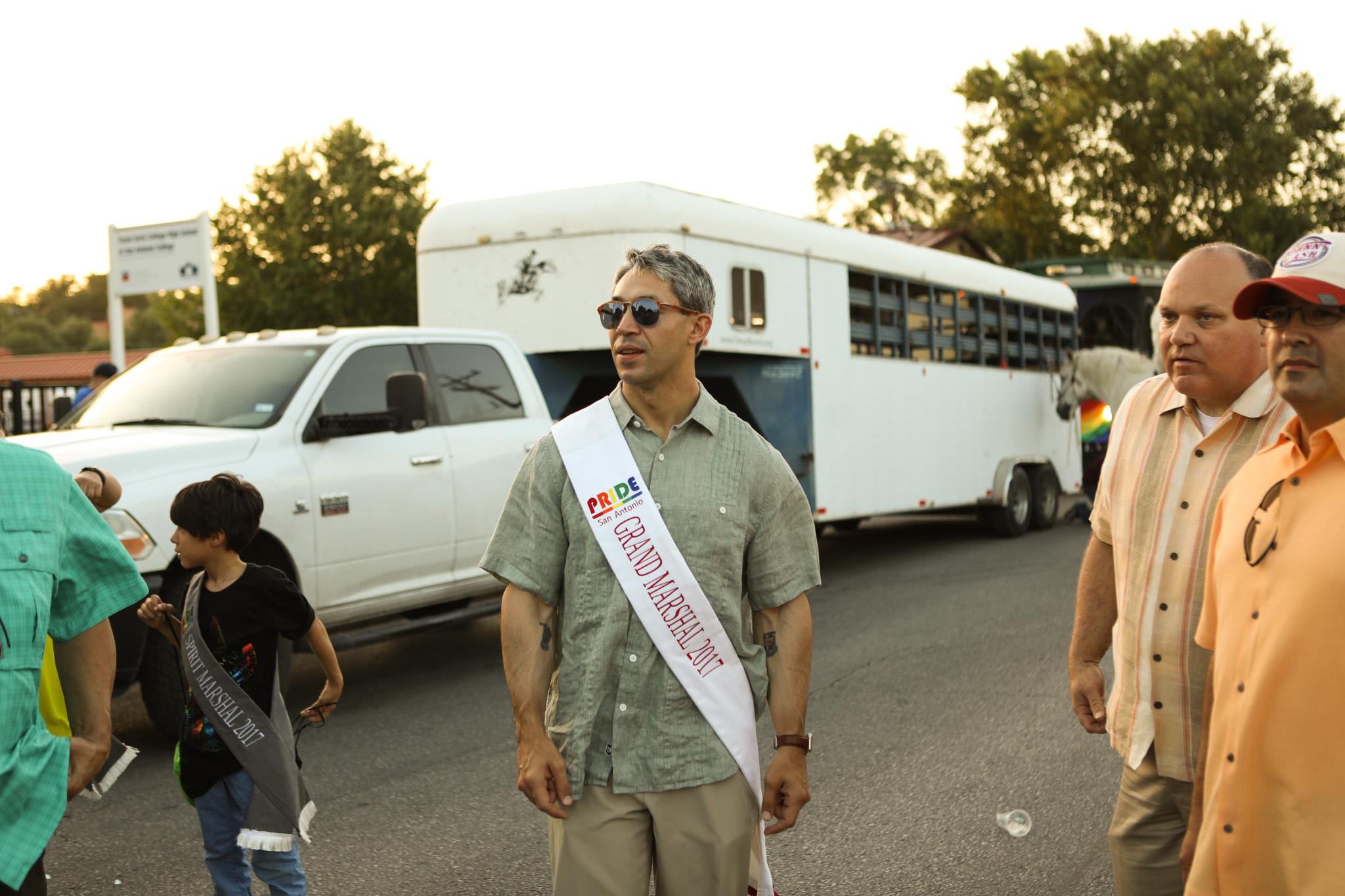 Mayor Ron Nirenberg dons his Grand Marshal 2017 sash for the PRIDE Bigger Than Texas Parade.