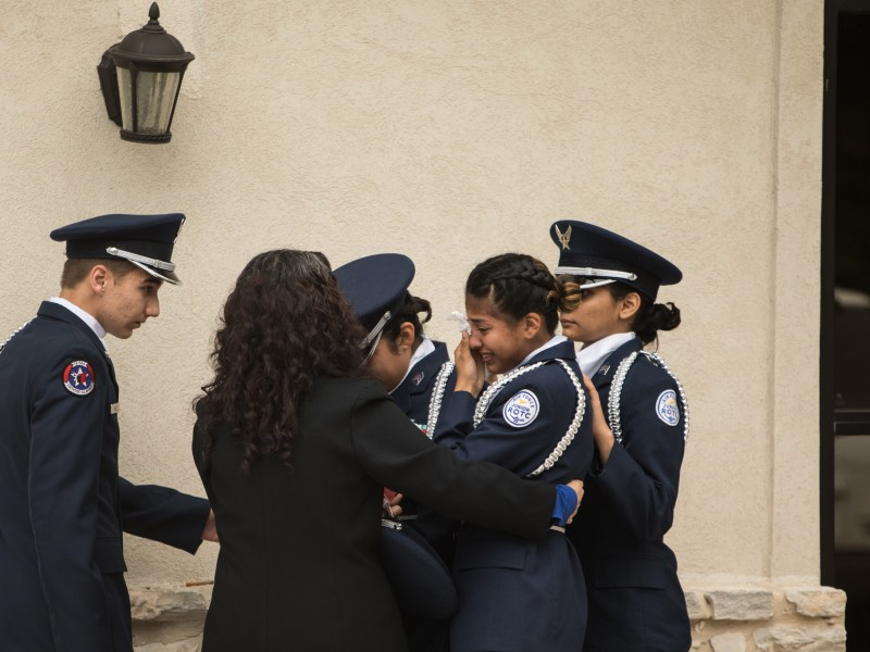 A young woman in the Air Force ROTC Unit TX 949 of Southside High School cries outside of the prayer service at Palm Heights Mortuary honoring deceased Isaiah Gonzalez.