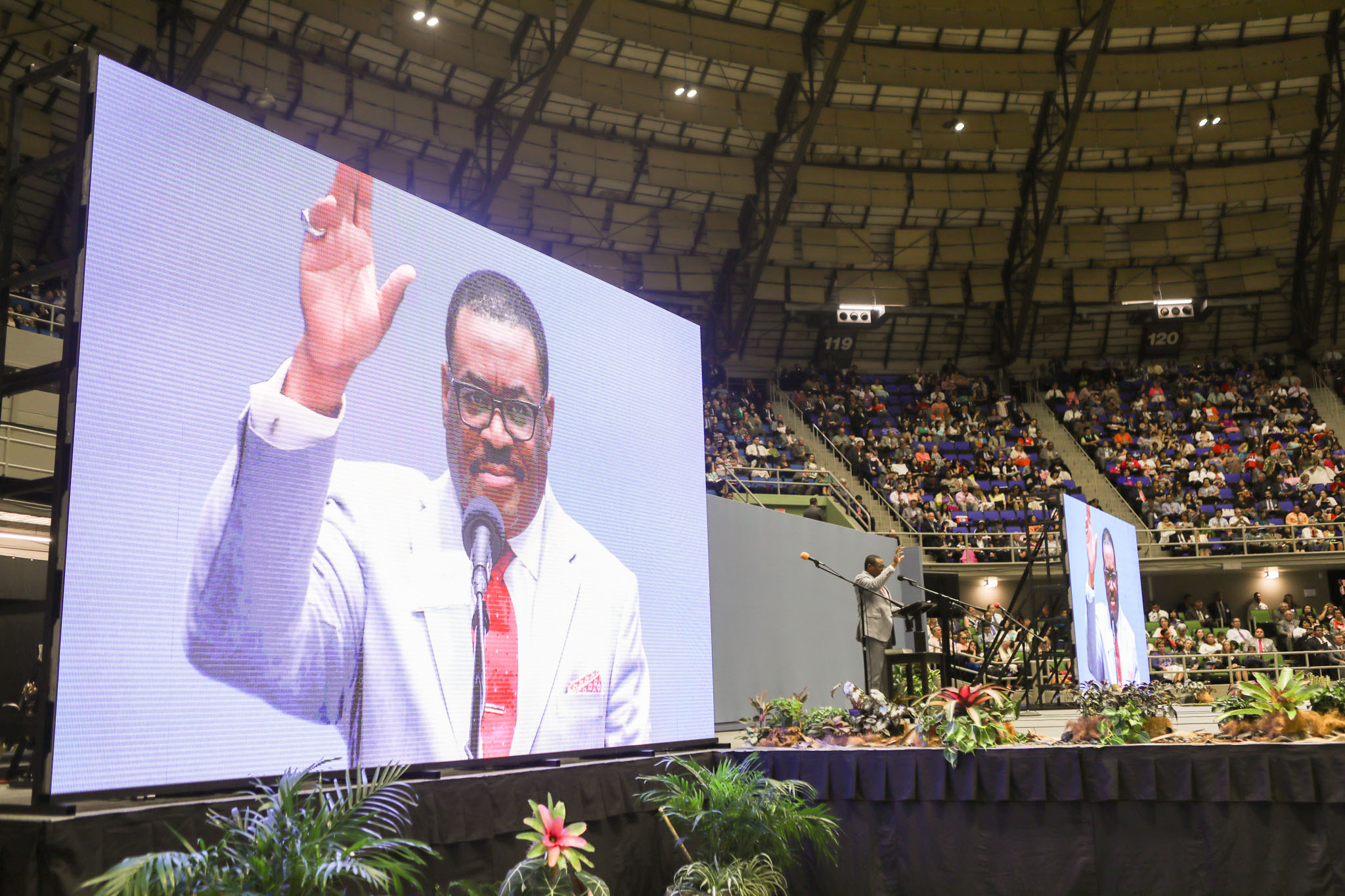 Ken Williams speaks to the audience during the 2017 convention of Jehovah's Witnesses in the Freeman Coliseum.