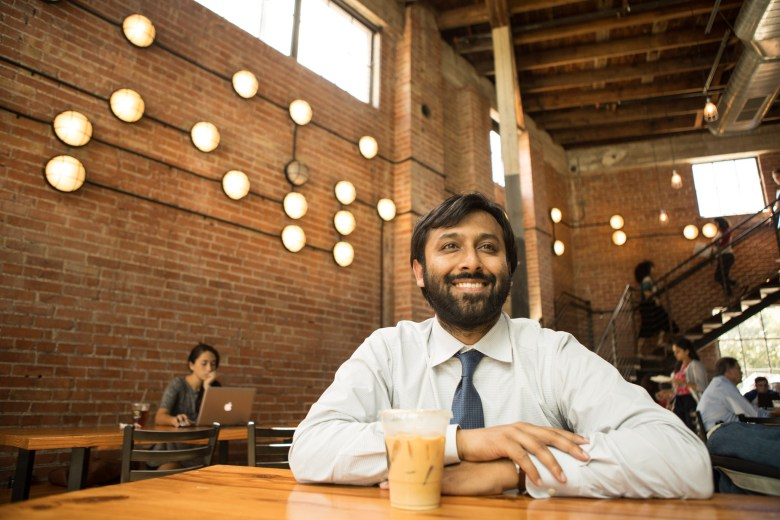 San Antonio Independent School District Chief Innovation Officer Mohammed Choudhury enjoys an iced coffee at Rosella.