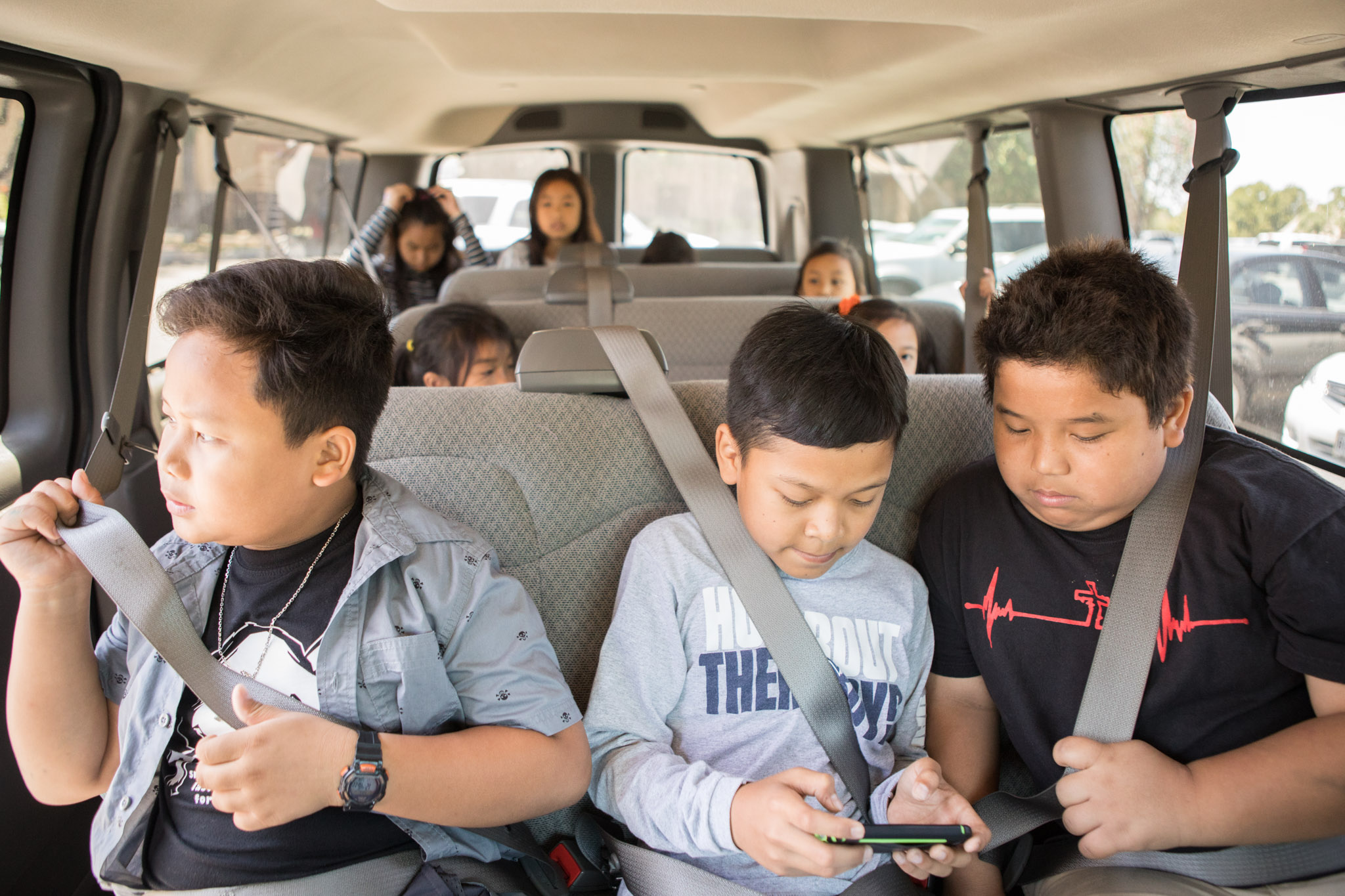 Students are driven home in a van after camp is done for the day.